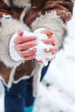 Hands of woman with snow heart Royalty Free Stock Image