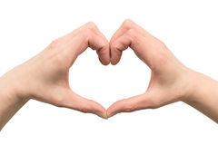 Hands of a woman stacked in the shape of a heart Stock Images