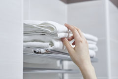 Hands, a woman takes towels in the bathroom royalty free stock photo