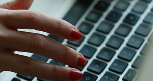 Hands of a woman typing on keyboard. Hands of a business woman typing on a laptop keyboard stock video