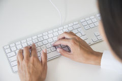 Hands of a woman typing on a keyboard Royalty Free Stock Photo