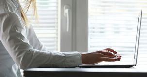 Hands of a woman typing on keyboard. Hands of a business woman typing on a laptop keyboard stock video footage