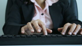 Hands of woman typing on the keyboard and using mouse with ambient sound stock video footage