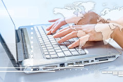 Hands of woman typing on the laptop Stock Photos