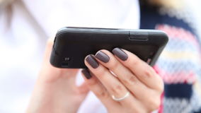 Hands of woman using cell phone smartphone.Full HD with motorized slider. 1080p. Royalty Free Stock Photography