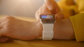 Hands of woman using her modern smart watches stock video footage