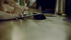 Hands of woman using tablet. Close up of woman hands using tablet in a bar stock footage