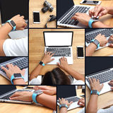 Hands of woman wearing smartwatch on laptop Stock Photo