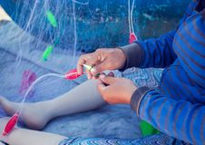 Hands woman weaving fishing nets Royalty Free Stock Photography