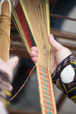 Hands of woman weaving traditional Lithuanian ethnic band from linen Royalty Free Stock Photos