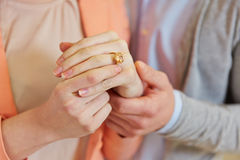 Hands of woman with wedding ring Stock Photo