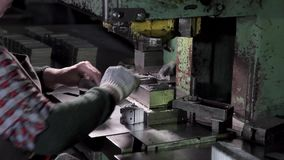 Hands of a woman working in the factory making fasteners stock video footage