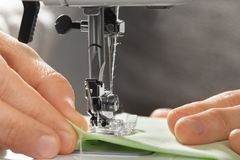 Hands of woman working on the sewing machine Royalty Free Stock Photography