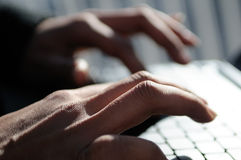 Hands of a woman writting with a laptop computer Royalty Free Stock Image