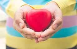 Hands women giving red heart Royalty Free Stock Photos