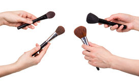 Hands  women holding  brush makeup isolated on white background. Stock Images