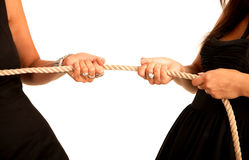 Hands women pull rope. White background Stock Photos