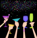 Hands of Women Raising Glasses in a Toast on Black. Hands raising glasses in a celebratory toast with confetti on a black background Stock Photos