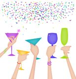 Hands of Women Raising Glasses in a Toast. Hands raising glasses in a celebratory toast with confetti Stock Images