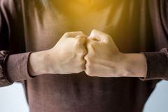 Hands of woman show strength teamwork,Fist bump and putting her hand. Hands of women show strength teamwork,Fist bump and putting her hand royalty free stock images