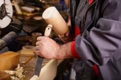 Hands woodcarver while working with the tools Royalty Free Stock Images