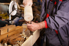 Hands woodcarver while working with the tools Royalty Free Stock Photos