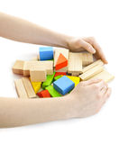 Hands with wooden block toys Royalty Free Stock Images