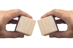 Hands with wooden blocks Stock Photos