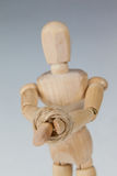 Hands of wooden figurine tied with a rope Stock Images
