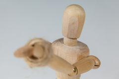 Hands of wooden figurine tied with a rope Stock Photos