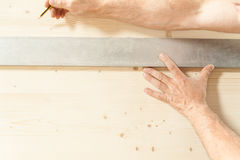 Hands of a woodworker in his carpentry Royalty Free Stock Images