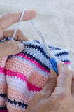 Hands with wool and crochet needle Stock Image
