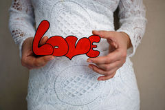 In the hands of the word `Love`. For Valentine Day Stock Image