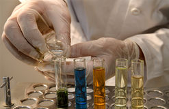 Hands by the work in laboratory Stock Images