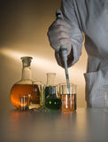 Hands by work in laboratory Stock Images