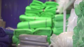 Hands of a worker in a commercial warehouse plastic awning stock video footage