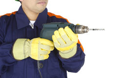 Hands of a worker holding a drill Royalty Free Stock Photography