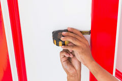 Hands worker holding measuring tape. Hands worker holding measuring tape on ceiling Stock Image
