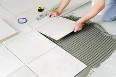 Laying Ceramic Tiles. Stock Photography