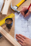 Hands of worker with pencil and blueprint on Stock Photo