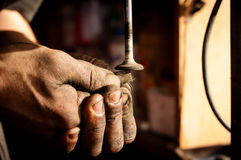 Hands of a worker polishing Stock Photography