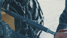 Hands of worker setting the attachments of tractor. stock video footage