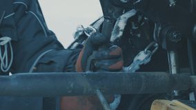 Hands of worker turning the equipment of tractor. stock video footage