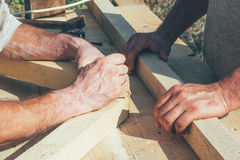 The hands of the workers carpenters. Joiners Royalty Free Stock Images
