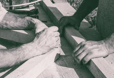 The hands of the workers carpenters. Joiners. black and white photo Stock Photos
