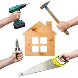 Hands of workers with tool and house. Hands of workers with tool on white background Stock Photography