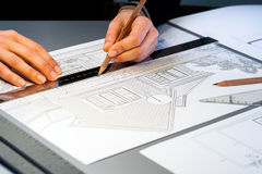 Hands working on architectural documents. Royalty Free Stock Photos