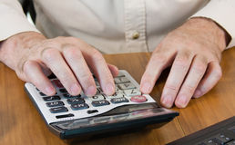 hands working on a calculator Royalty Free Stock Photo