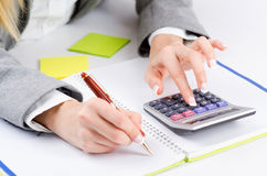 Hands working. On the calculator Royalty Free Stock Photography