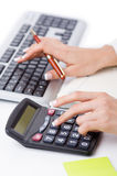Hands working. On the calculator Stock Image